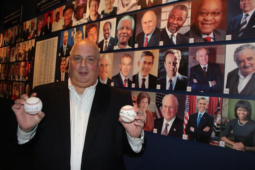 In this photo taken Friday, Sept. 30, 2016, Randy Kaplan holds autographed baseballs in Garden City, N.Y., signed by presidential candidates Donald Trump and Hillary Clinton. Kaplan has collected more than 200 signed baseballs from world leaders, including current and former U.S. presidents, prime ministers and others. The baseballs are on display at the Cradle of Aviation Museum on Long Island through next month's election. (AP Photo/Frank Eltman)