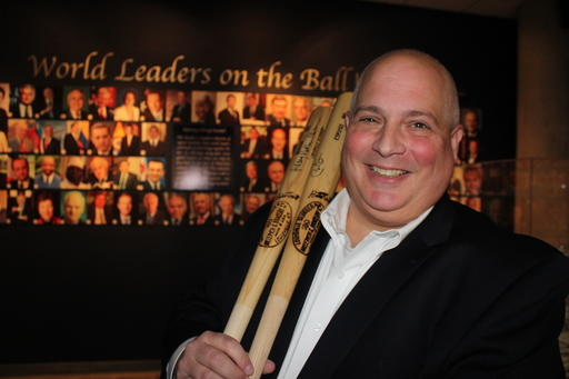 In this photo taken Friday, Sept. 30, 2016, Randy Kaplan holds autographed baseball bats in Garden City, N.Y., signed by President Barack Obama and Democratic presidential candidate Hillary Clinton. Kaplan has collected signed baseball bats from every living U.S. president, as well as more than 200 signed baseballs from world leaders, including current and former U.S. presidents, prime ministers and others. They are on display at the Cradle of Aviation Museum on Long Island through next month's election. (AP Photo/Frank Eltman)